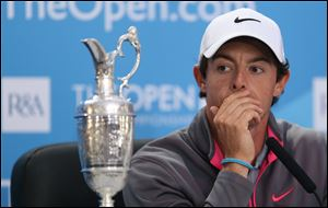 Rory McIlroy attends a press conference after winning the British Open Golf championship Sunday at the Royal Liverpool golf club, Hoylake, England.