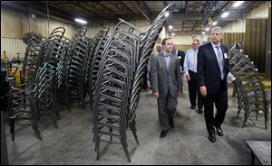 Michigan Lt. Gov. Brian Calley, left, goes on a tour of MTS Seating in Temperance with company's president, Barton S. Kulish.