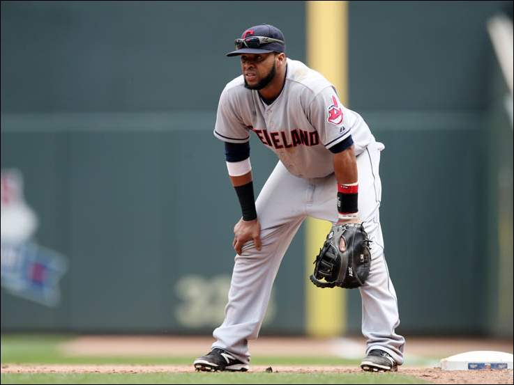 Cleveland Indians first baseman Carlos Santana plays against the Minnesota Twins.
