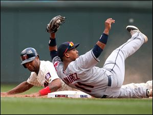 Cleveland Indians shortstop Jose Ramirez topples over after tagging out Minnesota Twins' Danny Santana as he attempted to steal second base.