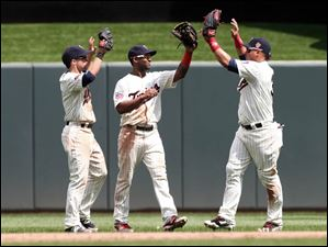 Minnesota Twins outfielders, from left, Sam Fuld, Danny Santana and Oswaldo Arcia celebrate their 3-1 win over the Cleveland Indians.