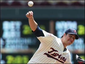 Minnesota Twins pitcher Anthony Swarzak throws against the Cleveland Indians.