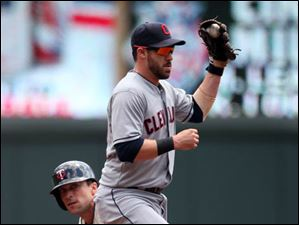 Minnesota Twins' Sam Fuld, bottom, is out at second by Cleveland Indians second baseman Jason Kipnis as he attempted to steal.