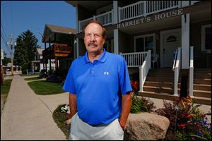 Denny Rectenwald stands in front of his business Harriet's House at Put-in-Bay. Mr. Rectenwald is upset with the Put-in-Bay police department after recently being handcuffed after being stopped for a traffic violation.