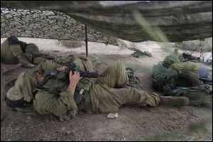 Israeli soldiers sleep near the border of  Israel and Gaza Strip.