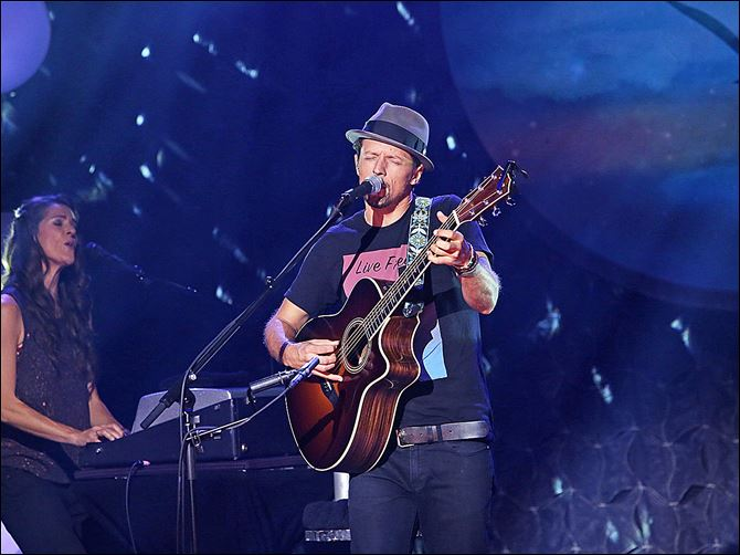 80532093 Grammy Award-winning artist Jason Mraz performs songs from his album '‍YES!' during a concert special on June 13 in Los Angeles.