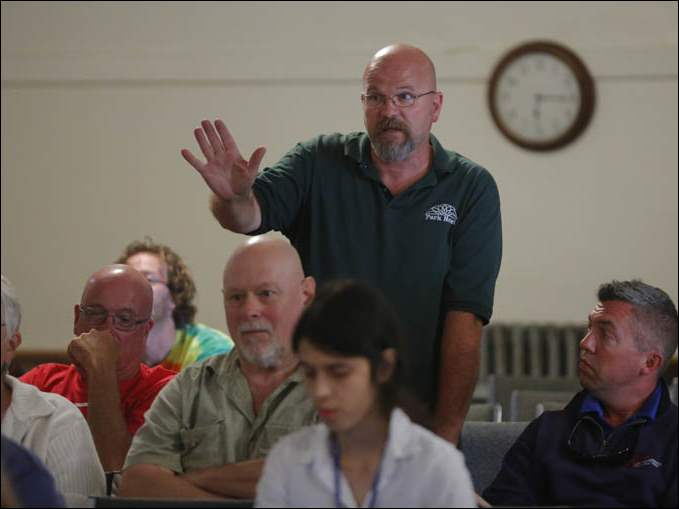 Phillip Boyles, manager at the Park Hotel, speaks during a public safety meeting at Put-in-Bay.