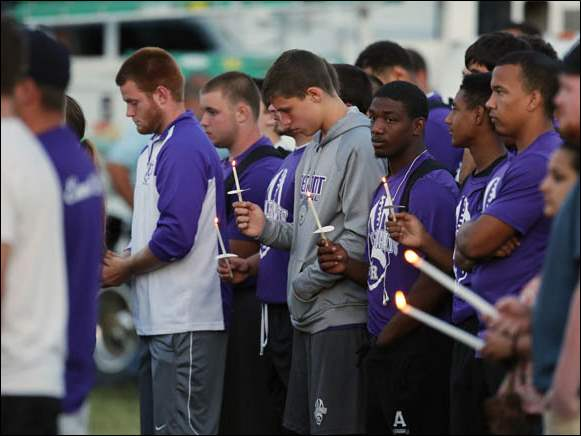 People attend a vigil for Cory Barron, whose manner of death remains a mystery.