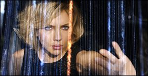 Johansson finds she can alter the very fabric of reality after she gains full use of her brain in 'Lucy.'
