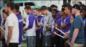 People attend a vigil on Thursday for Cory Barron, whose manner of death remains a mystery,  at Fremont Ross High School.