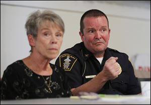 Mayor Margaret Scarpelli, left, listens as police Chief Ric Lampela makes a point during a public safety meeting at Put-in-Bay, Ohio.