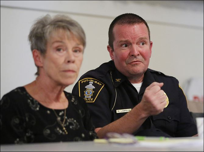 n6pib-2 Mayor Margaret Scarpelli, left, listens as police Chief Ric Lampela makes a point during a public safety meeting at Put-in-Bay, Ohio.