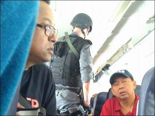 Armed guards inside the plane upon landing in Toronto.