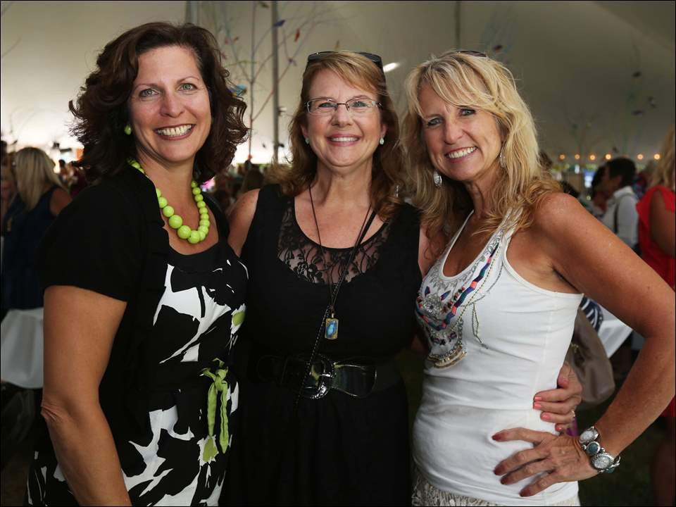 Sisters Ruth Light, of Perrysburg, left, Robin Kramer, of Sylvania, center, and Randi Damman, or Sylvania, right, attended this year's Chicks Mix at the Toledo Botanical Garden. Proceeds benefited Shared Lives Studio.