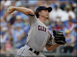 Cleveland Indians starting pitcher Josh Tomlin throws against the Kansas City Royals.
