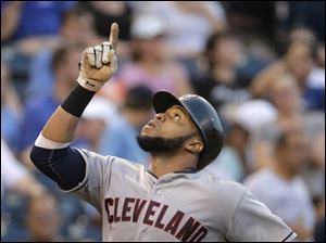 Cleveland Indians' Carlos Santana celebrates as he crosses the plate after hitting a home run.