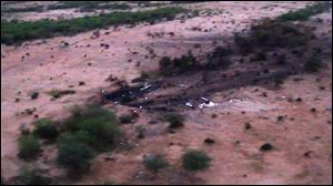 This photo provided by the French army shows the site of the plane crash in Mali. Terrorism hasn't been ruled out as a cause, although officials say the most likely reason for the catastrophe that killed all on board is bad weather.