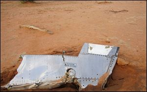 Part of the plane at the crash site in Mali. French soldiers secured a black box from the Air Algerie wreckage site in a desolate region of restive northern Mali today, the French president said.