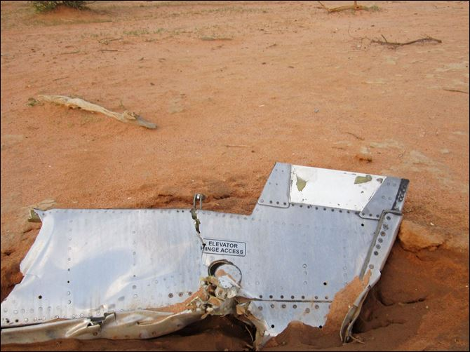 Mali Algeria Plane Part of the plane at the crash site in Mali. French soldiers secured a black box from the Air Algerie wreckage site in a desolate region of restive northern Mali today, the French president said.