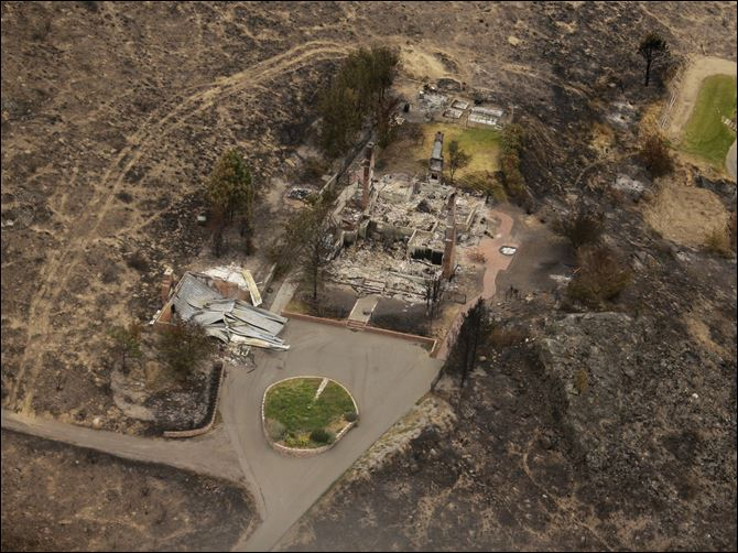 This aerial photo shows structures that were destroyed by wildfires near Pateros, Wash.
