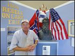 Dan Savage stands near a sculpture of abolitionist John Brown at the Lake Erie Islands Historical Society.