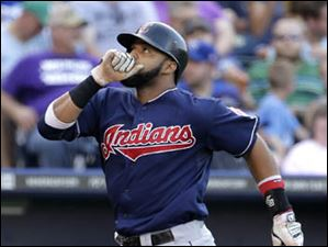 Cleveland Indians' Carlos Santana crosses the plate after hitting a solo home run.