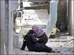 Palestinian Manal Keferna, 30, right, cries with her sister-in-law Najwa Keferna.