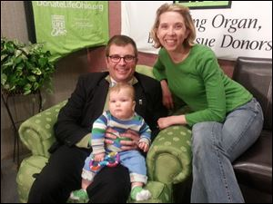 Jeff Abke, with his wife Rachel Abke and son Wally during a green chair sit-in in April to celebrate organ and tissue donation