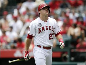 Los Angeles Angels' Mike Trout walks off the field after he struck out.