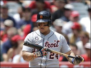 Detroit Tigers' Miguel Cabrera looks at his bat after swinging at a pitch.
