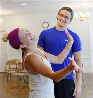 Deanna Welch, left, and Christian Siebenaler rehearse a scene from the Music Man with the Perrysburg Musical Theatre Company at  St. Timothy's Church.