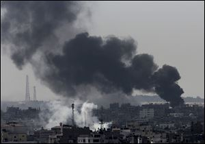 Smoke from Israeli strikes rises over Gaza City on Sunday in the northern Gaza Strip.