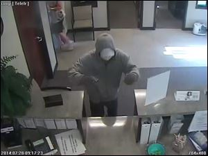 A photo of a suspect during a bank robbery this morning at the Toledo Co-Op Credit Union.