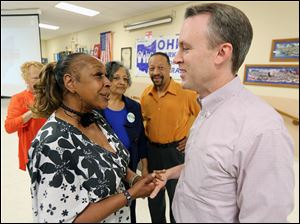 Democratic candidate for governor Ed FitzGerald greets United Auto Workers member Janice Fryer at the IBEW Local 8 in Rossford. The AFL-CIO hosted the event Monday for the Cuyahoga County executive.