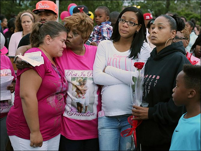 n3vigil Oleen Clinton, right, attends a vigil Monday for her son, Tyler McIntoush, who was shot to death last week on Collingwood Boulevard. With her at the Maritime Academy is, from left, Jodi Johns, principal of the school; Denise McIntoush, Tyler's grandmother, and Sierra Griswald, the slain youth's sister.