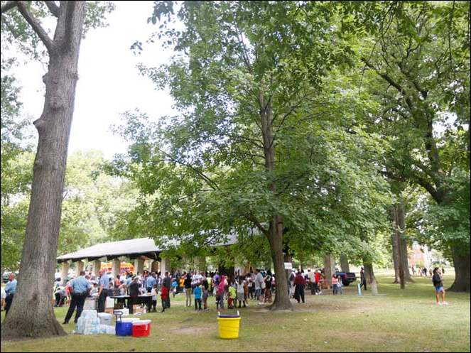 Hundreds of kids, parents and Toledo Police officers enjoy the afternoon in the park during the Toledo Police Department's annual crime prevention day at  the Ottawa Park Shelter House Monday.