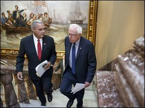 Senate Veterans' Affairs Committee Chairman Sen. Bernie Sanders, I-Vt., right and House Veterans' Affairs Committee Chairman Rep. Jeff Miller, R-Fla., take the stairs to a news conference on Capitol Hill, in Washington, Monday about a bipartisan deal to improve veterans' health care.