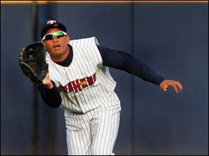 Toledo center fielder Ezequiel Carrera makes a catch deep in the outfield.