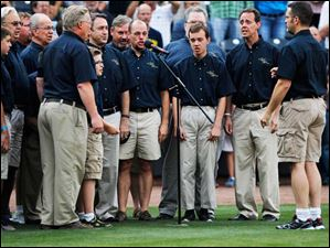 The Voices of Harmony sing the national anthem before the game the Toledo Mud Hens game against the Norfolk Tides.