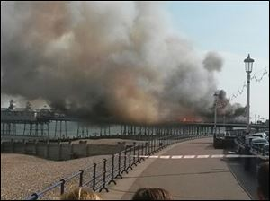A fire has broken out on Eastbourne Pier, East Sussex, England, Wednesday, July 30, 2014.