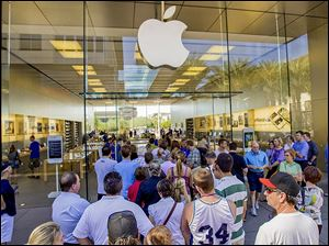 Customers enter an Apple Store  in Scottsdale, Ariz. An Apple Store location at Frank­lin Park Mall is planned some­time dur­ing the fourth quar­ter of 2014.