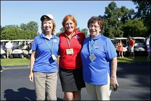 Volunteers, from left, A.J. Schweitzer, Heidi Wininger, and Trish Wicks during the Image Group Pro-Am Foursome on July 15.