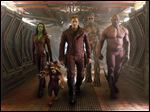 From left, Zoe Saldana, the character Rocket Racoon, voiced by Bladley Cooper, Chris Pratt, the character Groot, voiced by Vin Diesel and Dave Bautista in a scene from