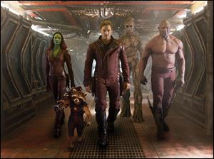 "From left, Zoe Saldana, the character Rocket Racoon, voiced by Bladley Cooper, Chris Pratt, the character Groot, voiced by Vin Diesel and Dave Bautista in a scene from ""Guardians of the Galaxy."""