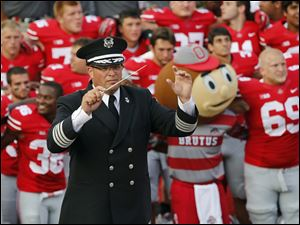 "Then Ohio State University marching band director Jon Waters leads the band in ""Carmen Ohio"" in September, 2013."