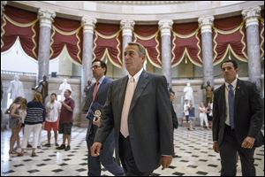 House Speaker John Boehner of Ohio strides to the House chamber  on Capitol Hill in Washington, Wednesday.