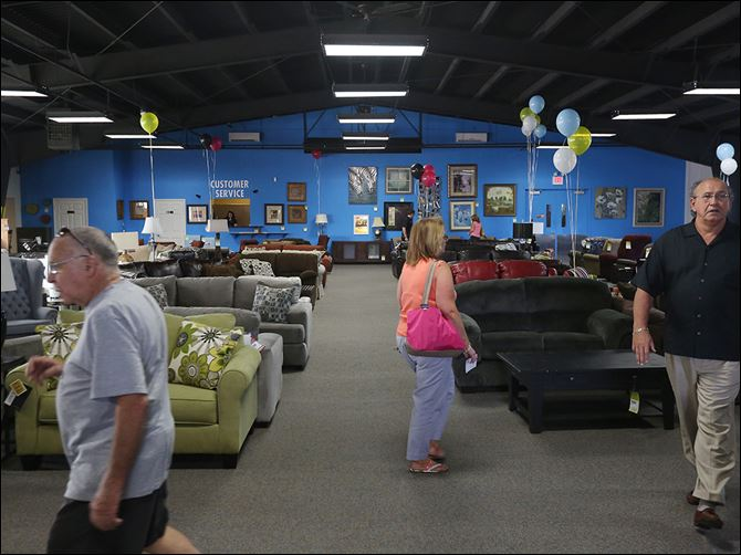 b6appliance Visitors take a look around inside one of the show rooms at the new Appliance Center Outlet in Maumee.