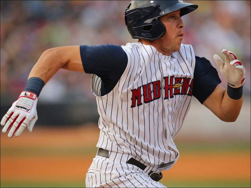 Toledo Mud Hens SS Hernan Perez singles against the Norfolk Tides during the third inning.