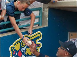 Carey, Ohio resident Alex Kear, 11, gets an autograph from Mud Hens hitting coach Leon