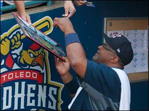 Toledoan Ken Peace gets an autograph from Mud Hens hitting coach Leon